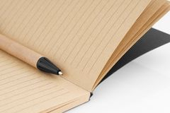 Writing pen with notepad. Royalty Free Stock Photos