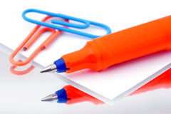 Writing pen on paper. Stock Image