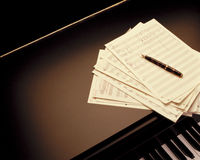Writing a piano music score Stock Photos