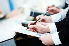 Writing plan. Close-up of business person hands with document writing at lecture Stock Image