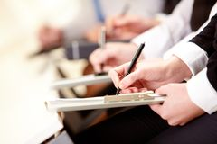 Writing plan. Close-up of business person hands with document writing at lecture Stock Photos