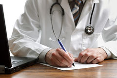 Writing a prescription or medical examination Royalty Free Stock Image