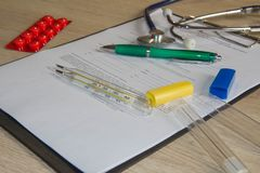 Writing prescription on paper. Health and medical concept royalty free stock photo