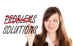 Writing problems over crossed solutions. Business woman writing problems over crossed solutions Stock Image