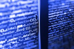 Writing programming code on laptop. Software source code royalty free stock images