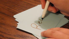 Writing real. Hand writing the word real on a card stock footage