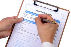 Writing registration form. Royalty Free Stock Images