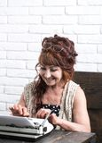 Writing a report. Old woman work in writer office. Journalist work in vintage office. Senior woman type on retro. Typewriter. Senior writer at desk. Female stock images