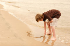 Writing in the sand Royalty Free Stock Photos