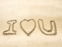 Writing on sand in the sea beach Stock Photos