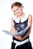 Writing schoolgirl Royalty Free Stock Images