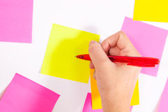 Writing on screen- Wall covered with sticky notes Royalty Free Stock Image