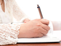 Writing secrets in the diary Royalty Free Stock Photo