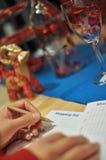 Writing shopping list for xmas season Stock Photo