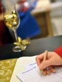 Writing shopping list for xmas season Royalty Free Stock Image