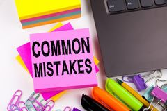 Writing showing Common Mistakes made in the office with surroundings such as laptop, marker, pen. Business concept for Common Deci Royalty Free Stock Photos