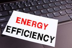 Writing showing Energy Efficiency made in the office with surroundings laptop marker pen. Business concept for Building Technology. Efficiency Workshop white royalty free stock image