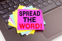 Writing showing Spread The Word made in the office with surroundings laptop marker pen. Business concept for Announcement Business. Marketing Message Workshop royalty free stock photo