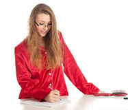 Writing smiles woman Stock Photography