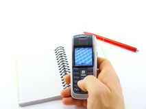 Writing sms. Hand holding phone and writing sms Royalty Free Stock Photography