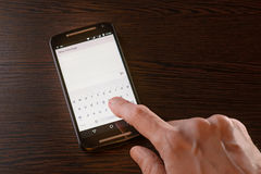 Writing Sms on Smartphone Stock Photography