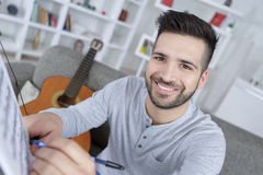 Writing song for guitar playing. Writing a song for guitar playing Stock Images