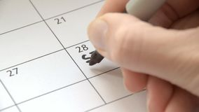 Writing Start College on calendar with a black marker stock video footage