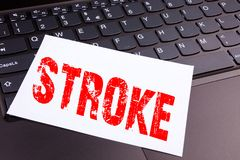 Writing Stroke text made in the office close-up on laptop computer keyboard. Business concept for Medicine health stethoscope illn Royalty Free Stock Images