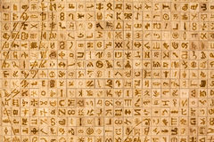 Writing Symbols. A wood background stamped with abstract symbols Stock Photography