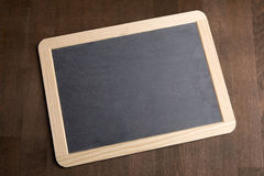 Writing tablet on a brown background Royalty Free Stock Photography
