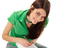 Writing teenager girl isolated Royalty Free Stock Images