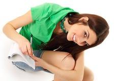 Writing teenager girl  on white Royalty Free Stock Image