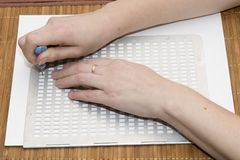 Writing text in Braille Stock Image