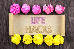 Writing text  Life Hacks. Concept meaning Solution Hacking Hack Trick To Help Efficiency written on sticky note paper with folded. Writing text  Life Hacks Royalty Free Stock Image