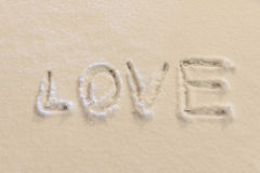 Writing text LOVE on the snow Stock Photography
