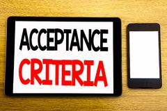 Writing text showing Acceptance Criteria. Business concept for Digital Criterion Written on tablet laptop, wooden background with. Writing text showing Royalty Free Stock Photos