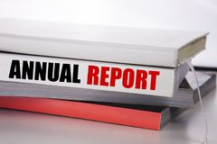 Writing text showing Annual Report. Business concept for Analyzing Performance  written on the book on the white background. Writing text showing Annual Report Stock Image
