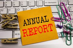 Writing text showing Annual Report. Business concept for Analyzing Performance  written on sticky note paper on the white keyboard. Writing text showing Annual Stock Images
