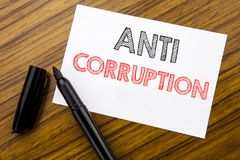 Writing text showing Anti Corruption. Business concept for Bribery Corrupt Text written on sticky note paper on the wooden backgro. Writing text showing Anti Stock Photo
