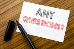 Writing text showing Any Questions. Business concept for Answer Help Question written on sticky note paper on the wooden backgroun Stock Image