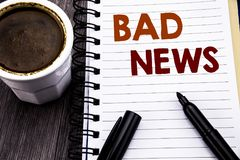 Writing text showing Bad News. Business concept for Failure Media Newspaper written on notebook book note paper on the wooden wood. Writing text showing Bad News Royalty Free Stock Photos