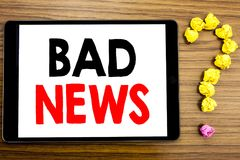 Writing text showing Bad News. Business concept for Failure Media Newspaper written on tablet computer on the wooden background wi. Writing text showing Bad News Stock Photos