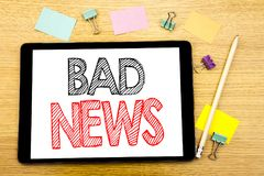 Writing text showing Bad News. Business concept for Failure Media Newspaper Written on tablet laptop, wooden background with stick. Writing text showing Bad News Royalty Free Stock Photography
