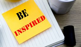 Writing text showing Be Inspired. Business concept for Inspiration and Motivation written sticky note empty paper, Wooden backgrou. Writing text showing Be Royalty Free Stock Photos