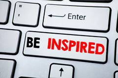 Writing text showing Be Inspired. Business concept for Inspiration and Motivation written on white keyboard key with copy space. T. Op view Royalty Free Stock Photos