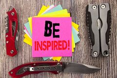 Writing text showing Be Inspired. Business concept for Inspiration, Motivation Written on sticky note wooden background with pocke. Writing text showing Be Stock Image
