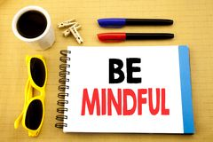 Writing text showing Be Mindful. Business concept for Mindfulness Healthy Spirit written on sticky note with copy space on old woo. Writing text showing Be Royalty Free Stock Photo