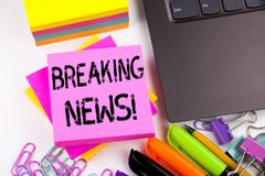 Writing text showing Breaking News made in the office with surroundings such as laptop, marker, pen. Business concept for Newspape Stock Photography