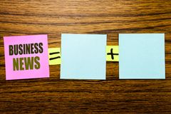 Writing text showing Business News. Business concept for Modern Online News written on sticky note paper on wooden background. Equ. Writing text showing Business Royalty Free Stock Photo