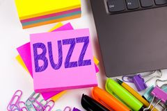 Writing text showing Buzz made in the office with surroundings such as laptop, marker, pen. Business concept for Buzz Word llustra. Tion Workshop white Stock Image